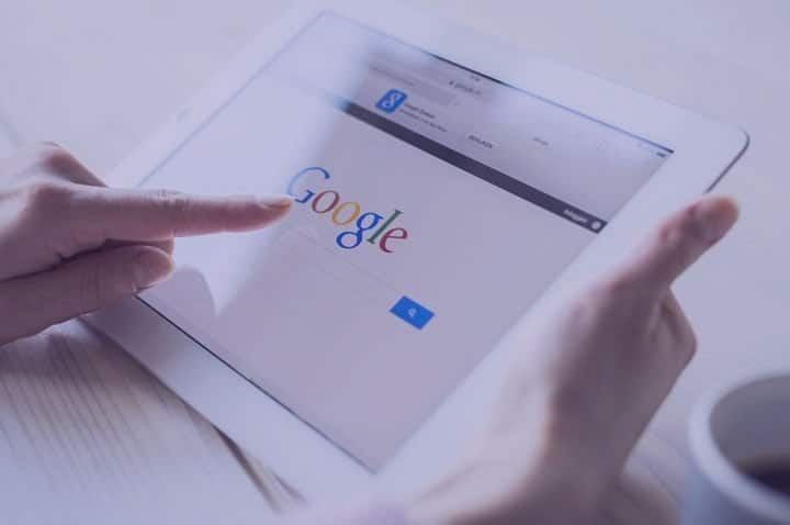 Person using Google on an iPad